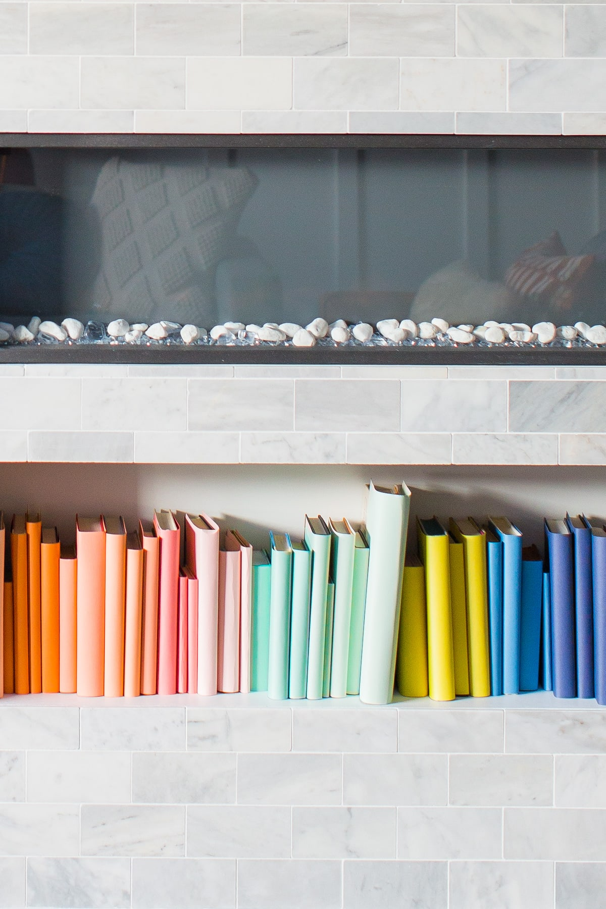 DIY Color-Coded Bookshelf by top Houston lifestyle blogger Ashley Rose of Sugar and Cloth