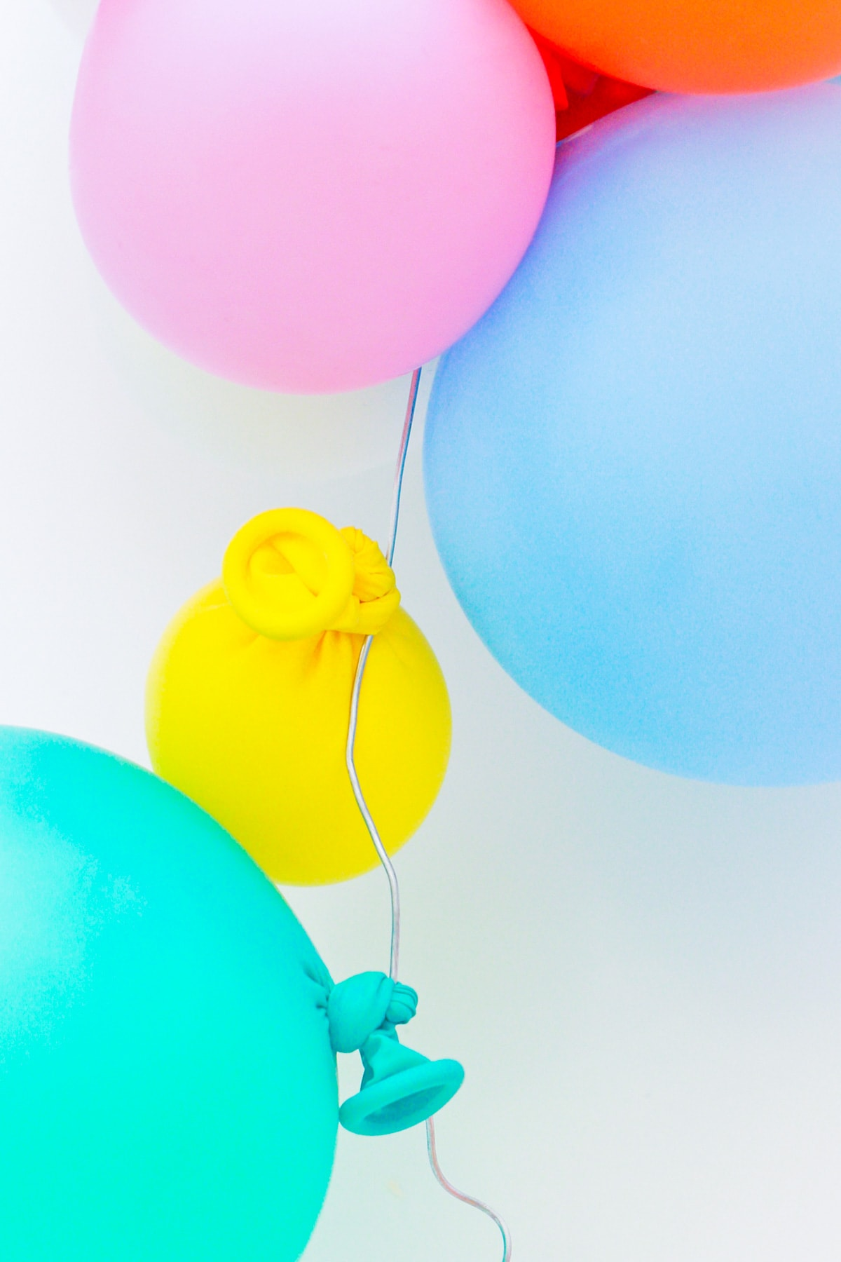 Step 4 - DIY Balloon Garland Cake Topper by top Houston lifestyle Blogger Ashley Rose of Sugar & Cloth - DIY DECOR #DIY #decor #balloon #balloongarland #party #celebrate #birthday #garland #diydecor