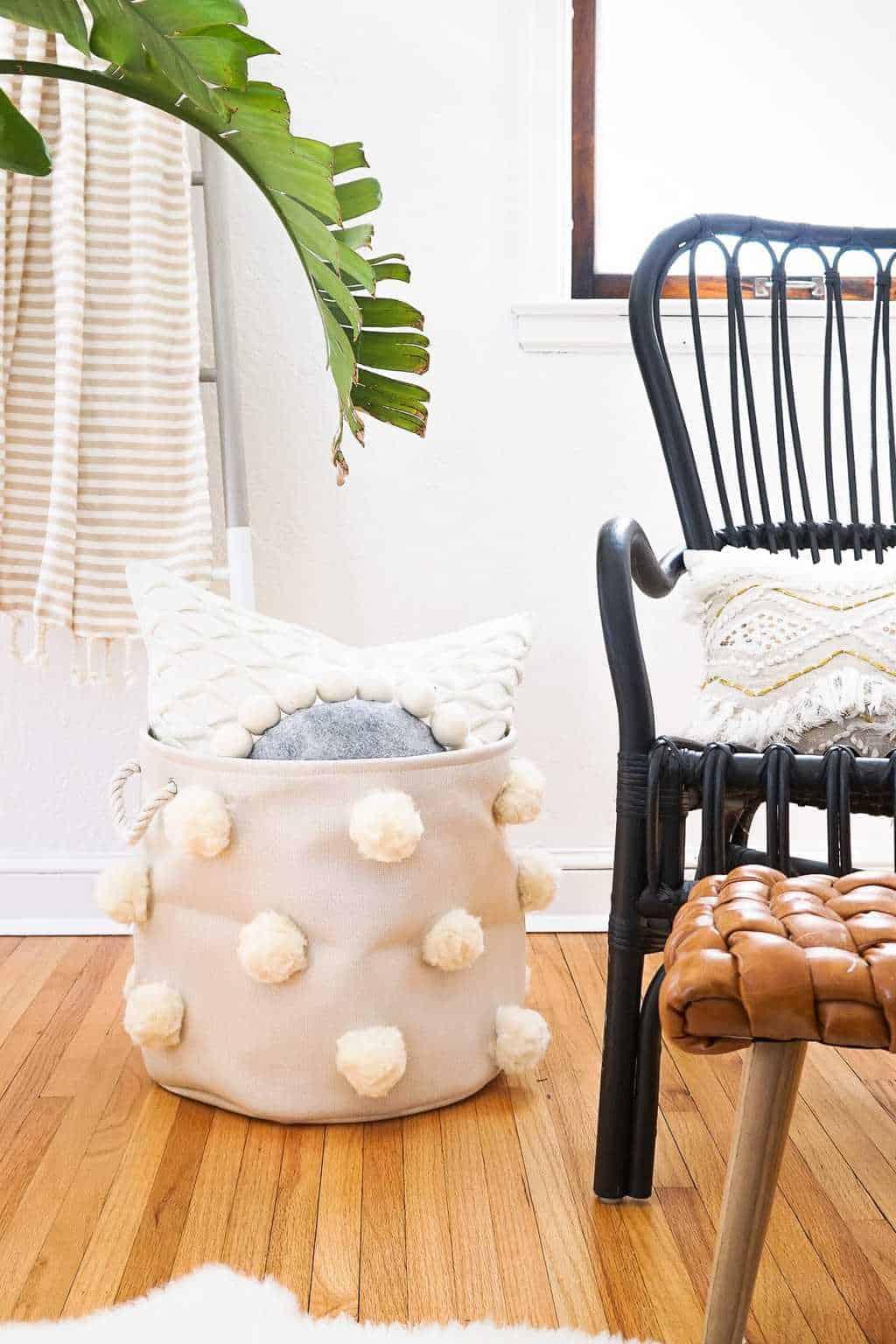 DIY Fluffy Pom Pom Bin by a chair