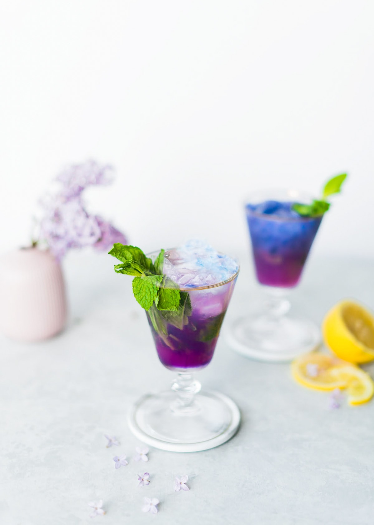 photo of the Butterfly Pea Flower Tea Cocktail changing from blue tea to purple by top Houston lifestyle blogger Ashley Rose of Sugar & Cloth