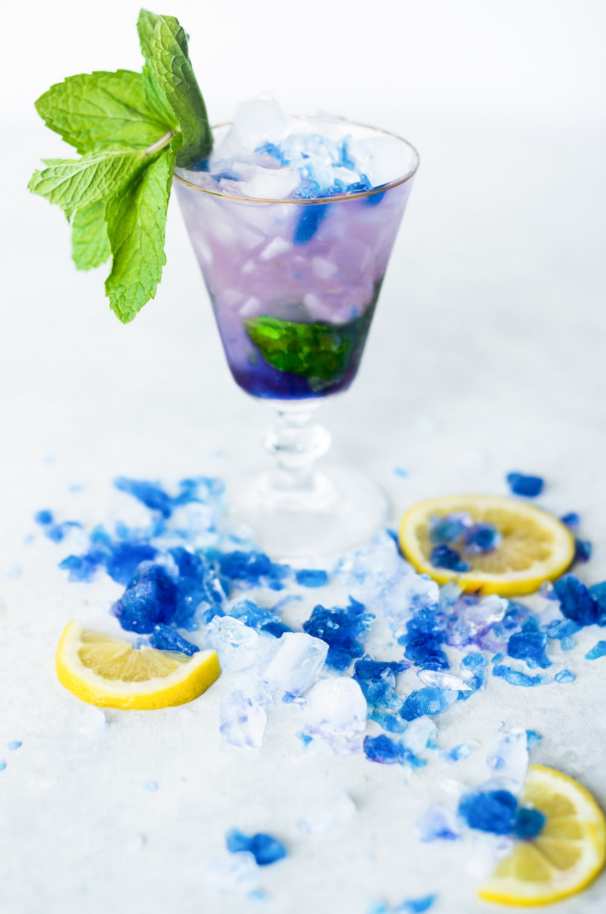 photo of a mood ring color changing galaxy cocktail by top Houston lifestyle blogger Ashley Rose of Sugar & Cloth
