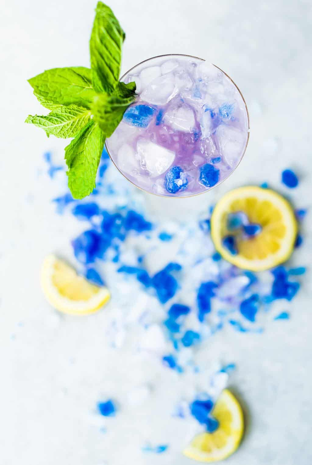 photo of the Butterfly Pea Flower Tea Cocktail from above by top Houston lifestyle blogger Ashley Rose of Sugar & Cloth