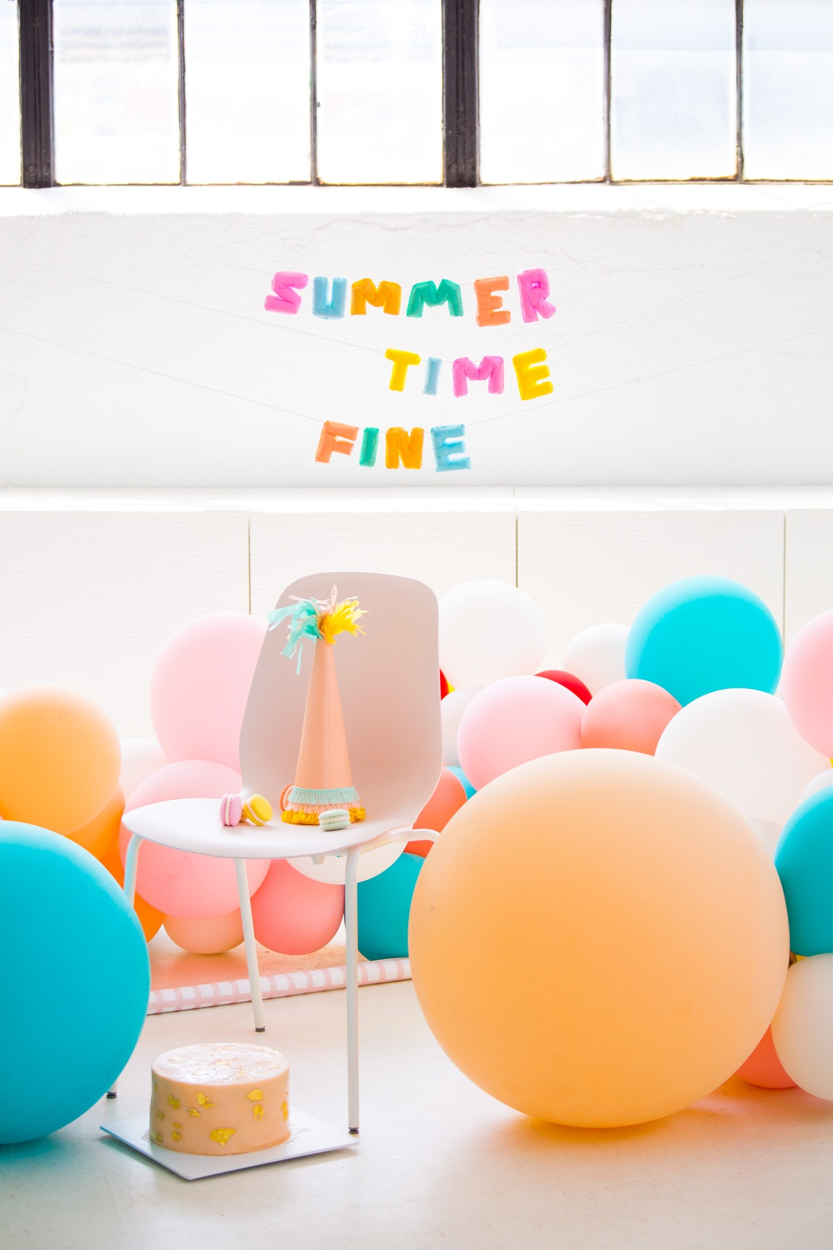 summer time fine! letter balloons that won't deflate - Faux Balloon DIY Letter Garland by Houston lifestyle blogger Ashley Rose of Sugar and Cloth #diy #balloons #balloongarland #garland #decor #party #ideas #howto