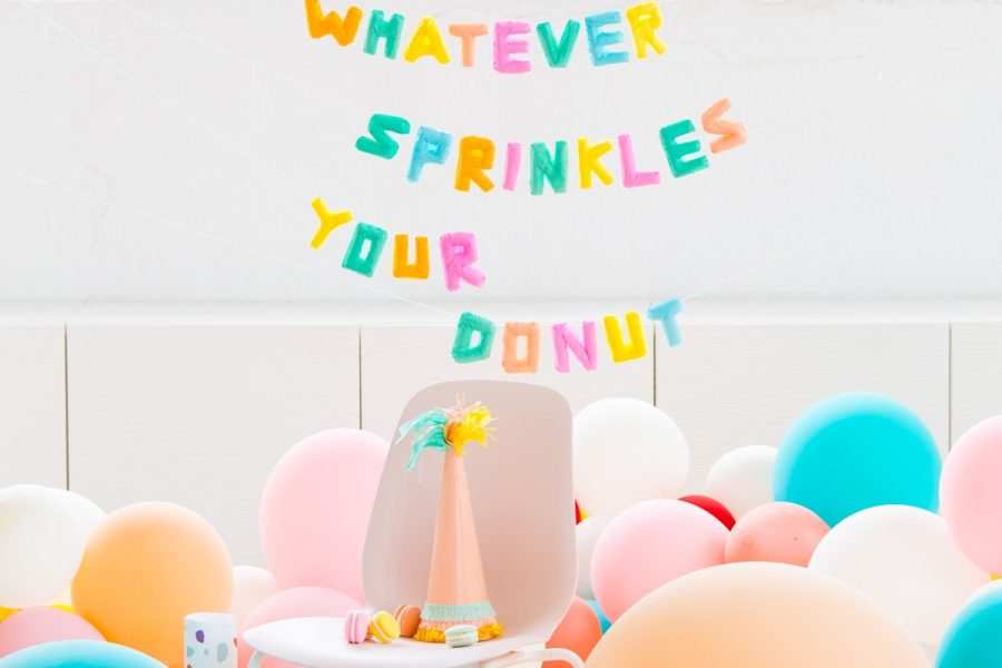 photo of a sprinkles and donut balloon garland decoration idea by sugar and cloth