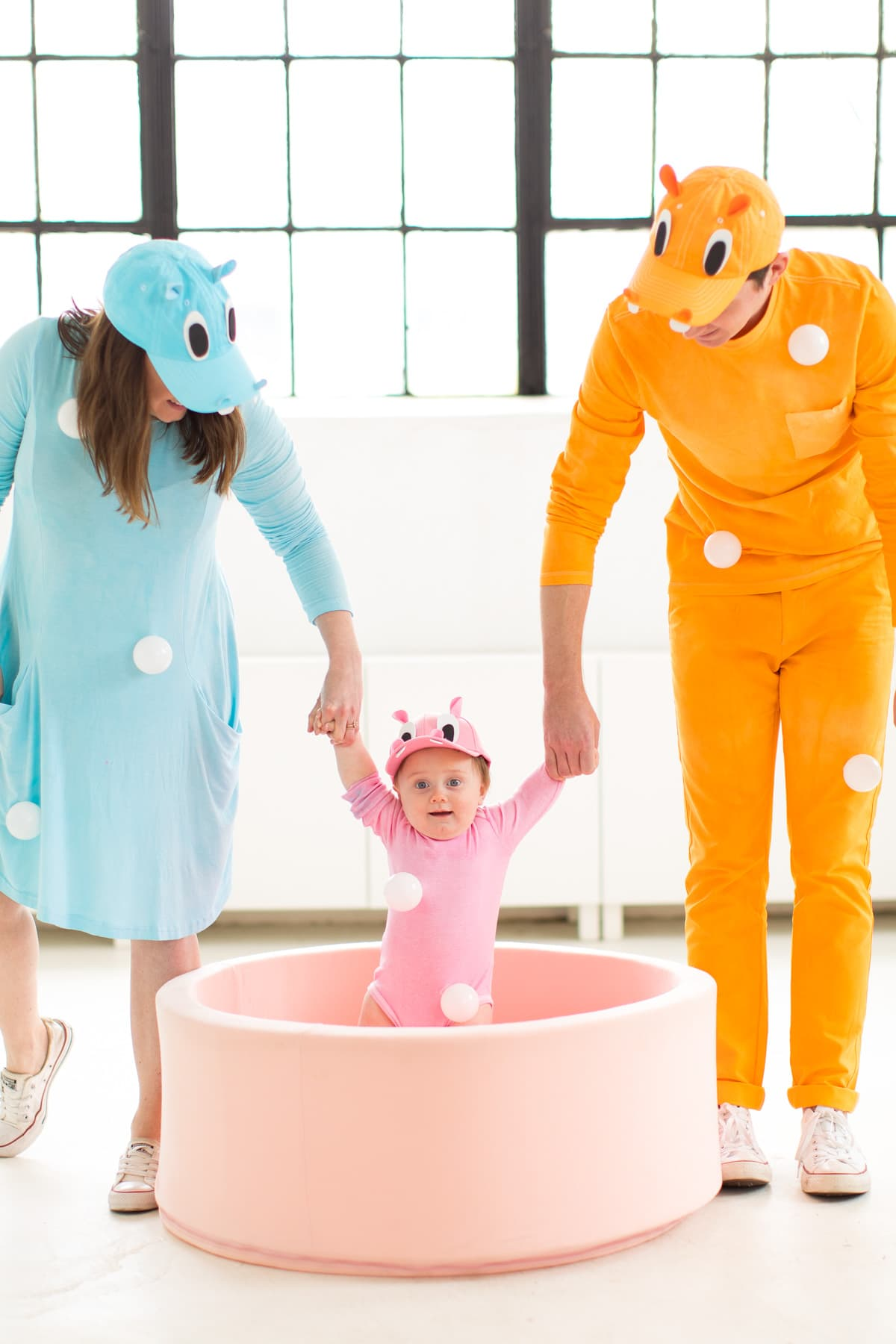 and you can't go wrong with a pink ball pit too, haha! -- loading up the crazy amount of baby gear! Our Family DIY Hungry Hippos Costume Idea -- by Top Houston blogger Ashley Rose of Sugar and Cloth -- #costumes #halloween #ideas #family #familycostume #diy
