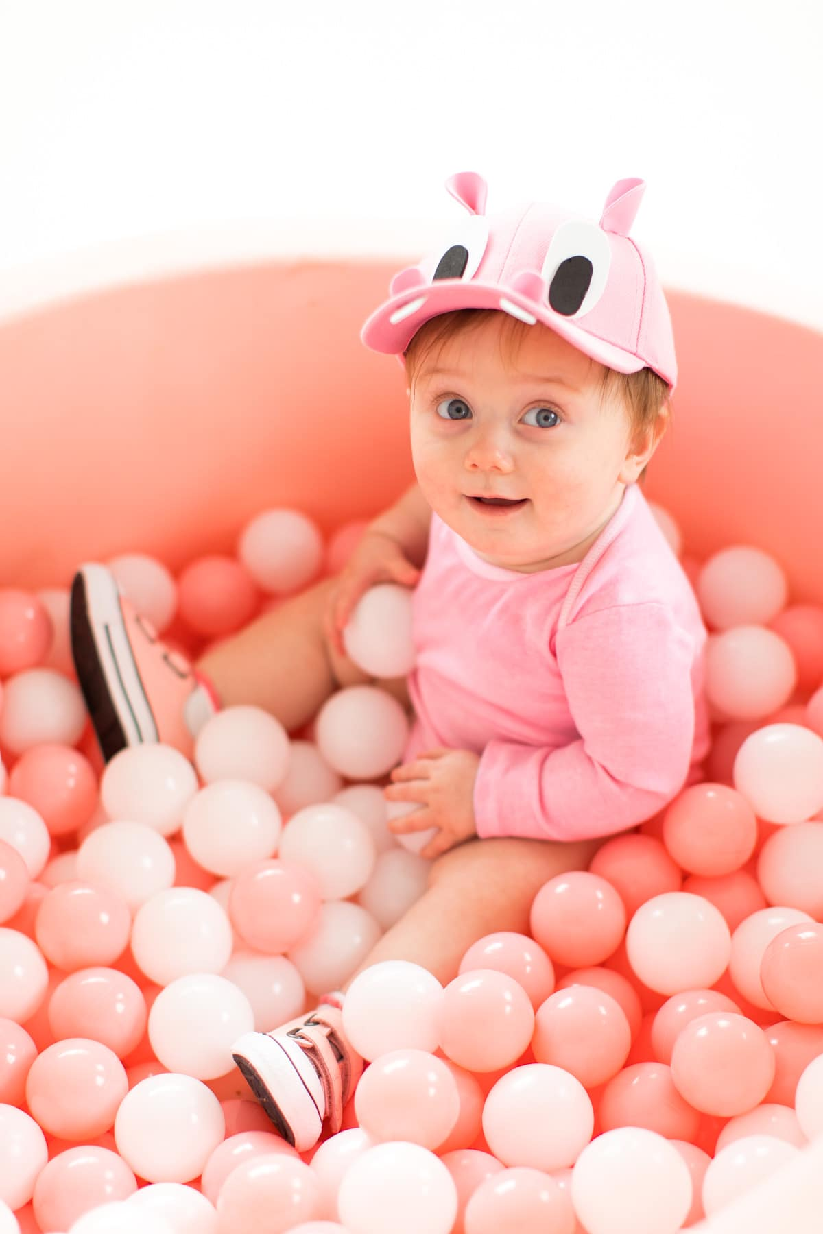 Gwen in her cute pink felt ball pit! -- loading up the crazy amount of baby gear! Our Family DIY Hungry Hippos Costume Idea -- by Top Houston blogger Ashley Rose of Sugar and Cloth -- #costumes #halloween #ideas #family #familycostume #diy