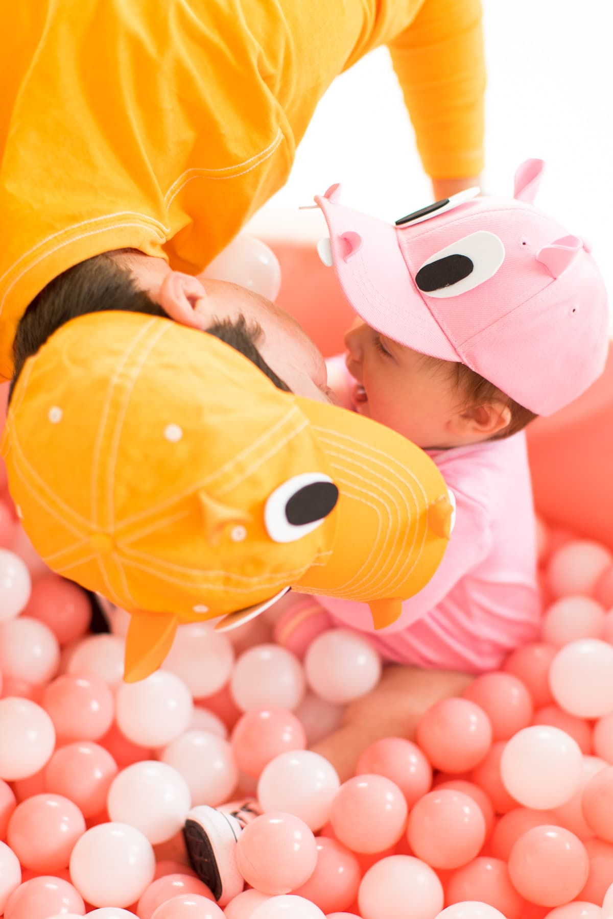 hippo kisses! -- loading up the crazy amount of baby gear! Our Family DIY Hungry Hippos Costume Idea -- by Top Houston blogger Ashley Rose of Sugar and Cloth -- #costumes #halloween #ideas #family #familycostume #diy