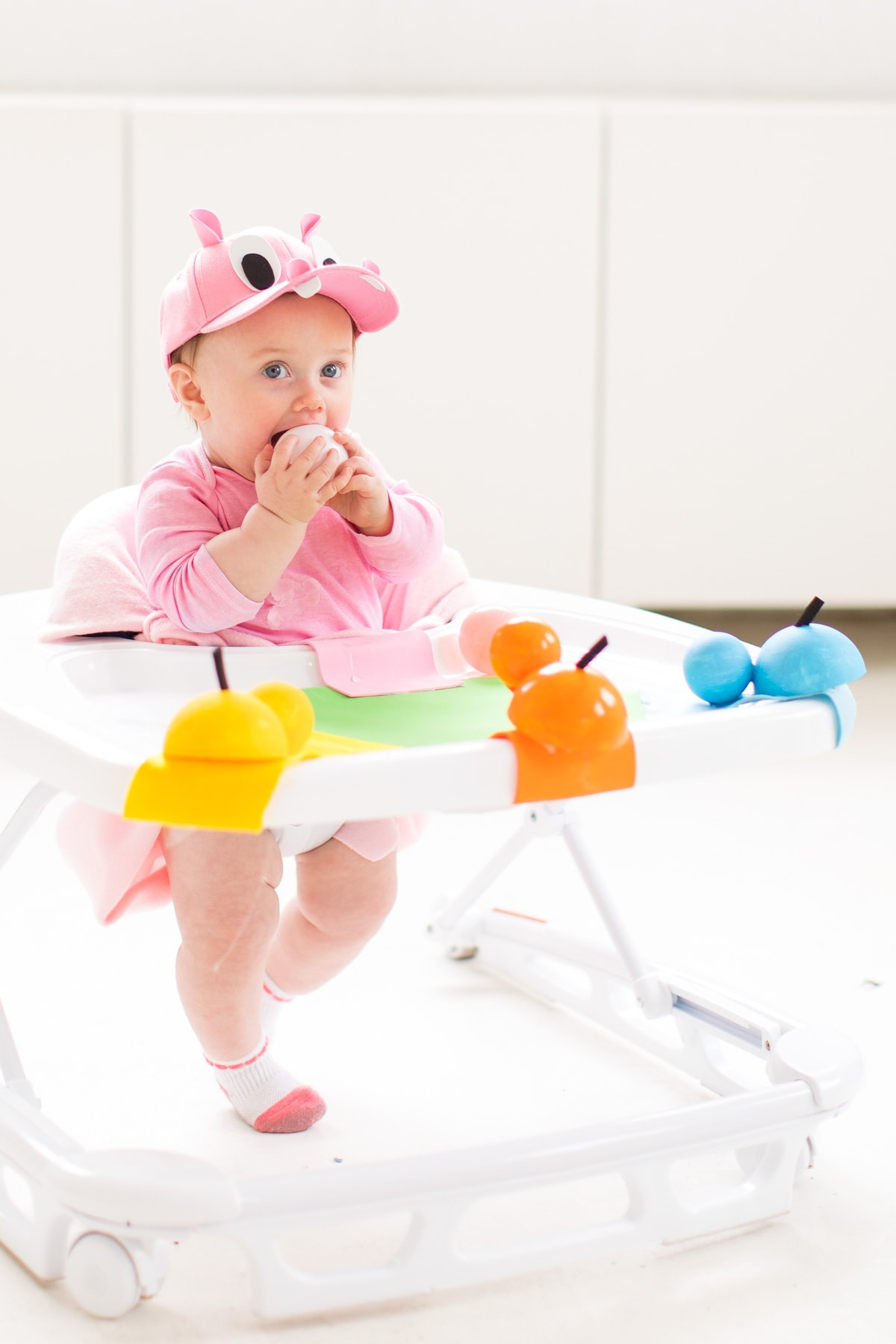 and of course we had to turn her walker into the hippo game! -- loading up the crazy amount of baby gear! Our Family DIY Hungry Hippos Costume Idea -- by Top Houston blogger Ashley Rose of Sugar and Cloth -- #costumes #halloween #ideas #family #familycostume #diy