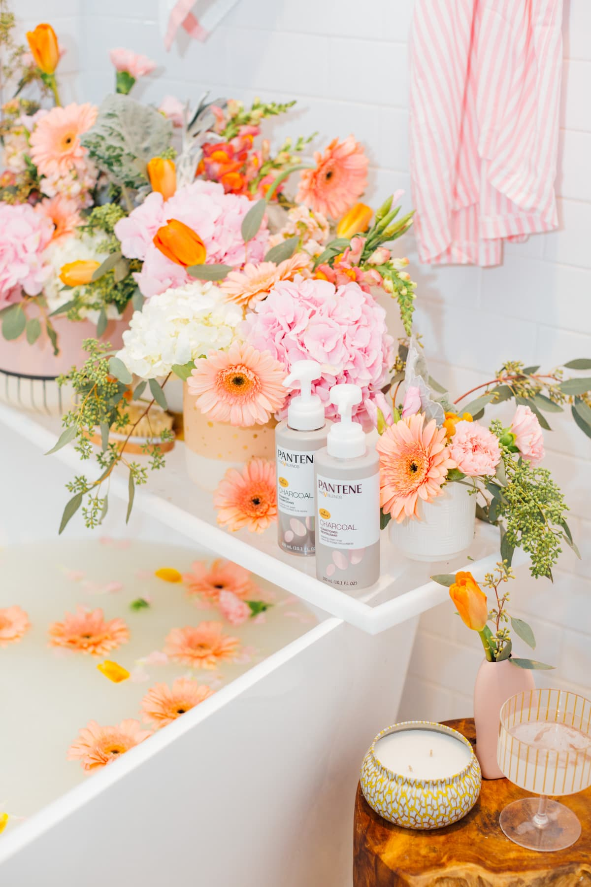a flower milk bath and pantene charcoal shampoo - My Easy Self-Care Tips for Feeling Confident in Yourself (Especially After Baby) - by top Houston lifestyle blogger Ashley Rose of Sugar and Cloth #beauty #tips #selfcare #hair #hairstyles #florals #flowers #showers