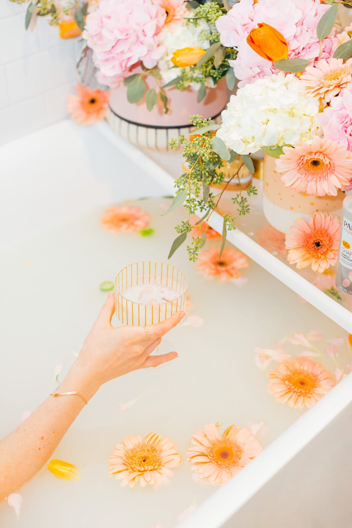 a glass of wine and a flower milk bath - My Easy Self-Care Tips for Feeling Confident in Yourself (Especially After Baby) - by top Houston lifestyle blogger Ashley Rose of Sugar and Cloth #beauty #tips #selfcare #hair #hairstyles #florals #flowers #showers