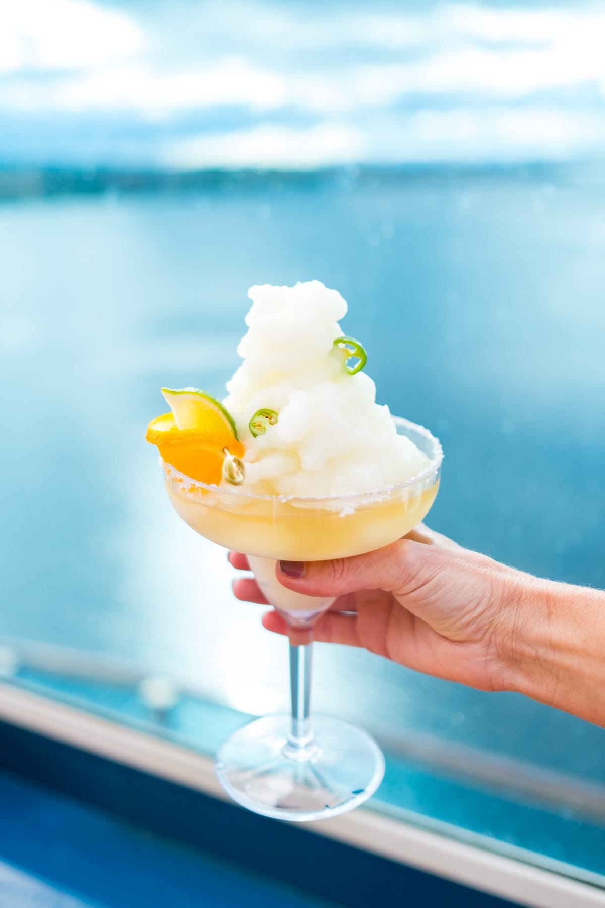 cruise life! a yummy Frozen Three Citrus Margarita Recipe with a Kick! by top Houston lifestyle blogger Ashley Rose of Sugar and Cloth #recipe #recipe #margarita #cocktails #cocktailrecipe #citrus #travel