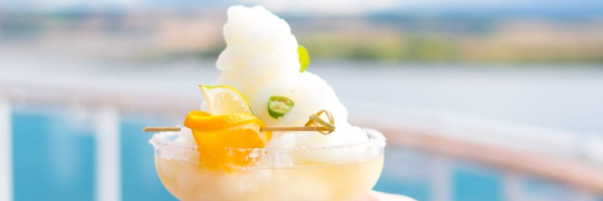 the infamous a yummy Frozen Three Citrus Margarita Recipe with a Kick! by top Houston lifestyle blogger Ashley Rose of Sugar and Cloth #recipe #recipe #margarita #cocktails #cocktailrecipe #citrus #travel