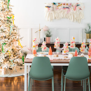 a cozy Christmas dinner table setting - Faux Flower Bottle Brush Tree DIY Christmas Centerpiece Idea by top Houston lifestyle blogger Ashley Rose of Sugar and Cloth #diy #christmas #decor #howto #craft #entertaining #centerpiece #ideas
