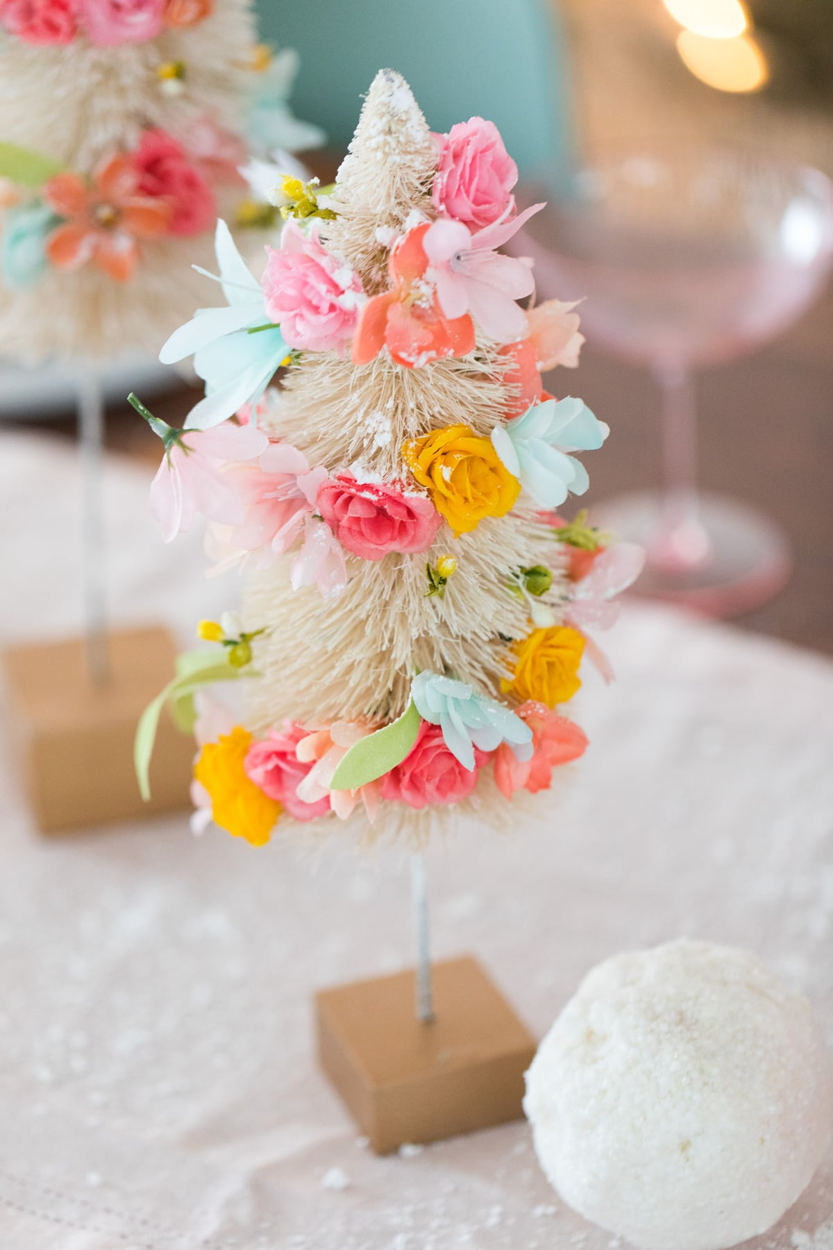 the final product! Faux Flower Bottle Brush Tree DIY Christmas Centerpiece Idea by top Houston lifestyle blogger Ashley Rose of Sugar and Cloth #diy #christmas #decor #howto #craft #entertaining #centerpiece #ideas