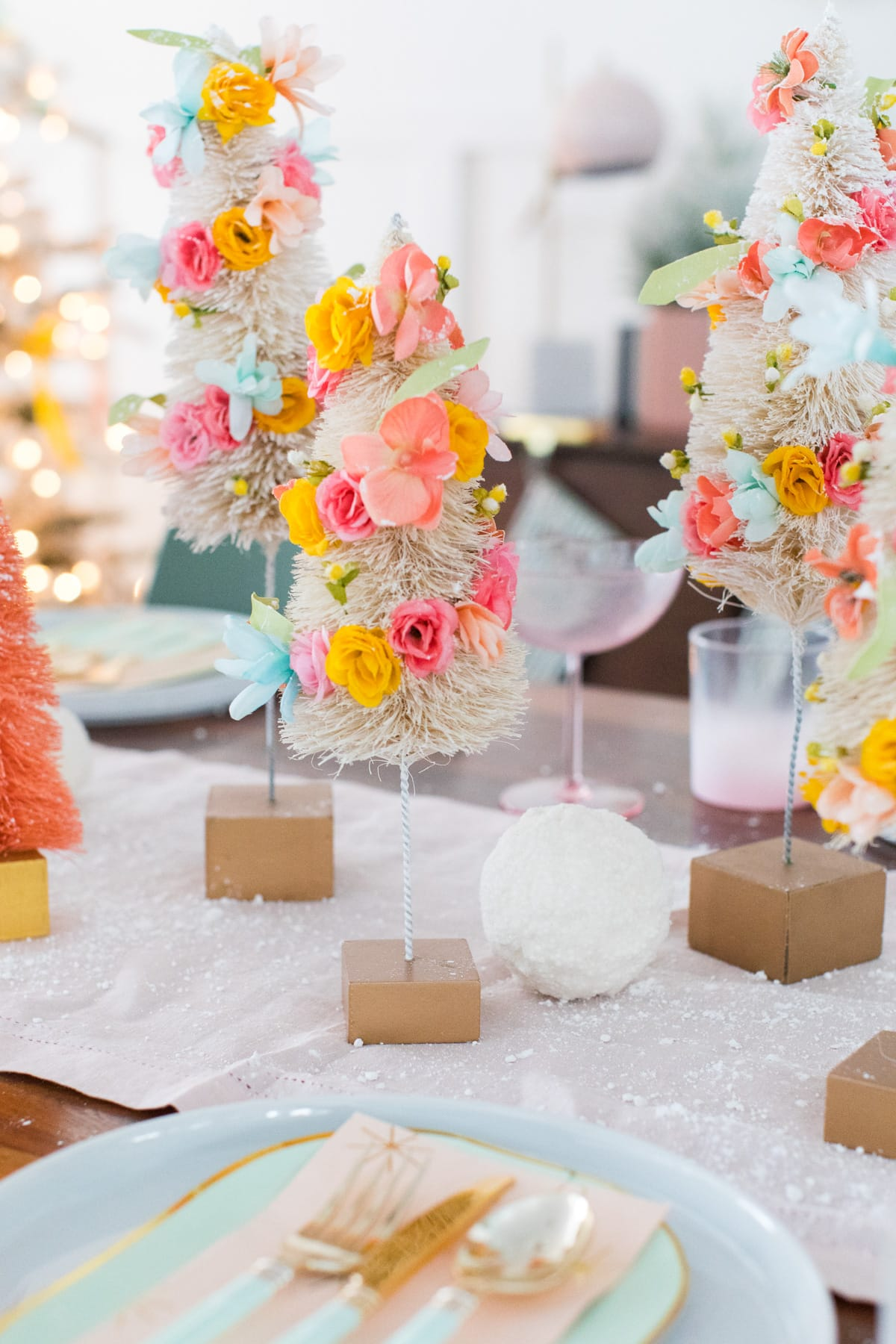 or mix them with faux snowballs - Faux Flower Bottle Brush Tree DIY Christmas Centerpiece Idea by top Houston lifestyle blogger Ashley Rose of Sugar and Cloth #diy #christmas #decor #howto #craft #entertaining #centerpiece #ideas