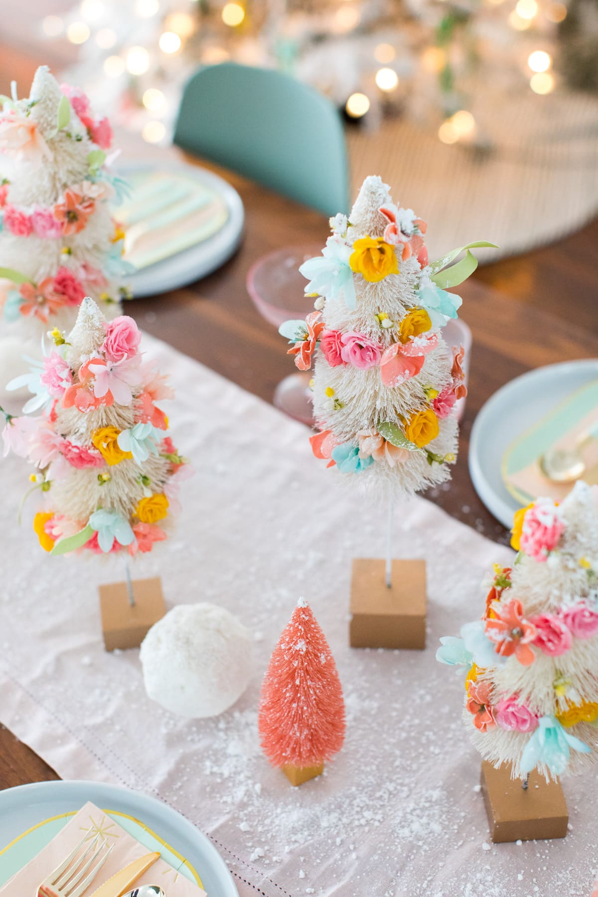 I love how they turned out! Faux Flower Bottle Brush Tree DIY Christmas Centerpiece Idea by top Houston lifestyle blogger Ashley Rose of Sugar and Cloth #diy #christmas #decor #howto #craft #entertaining #centerpiece #ideas