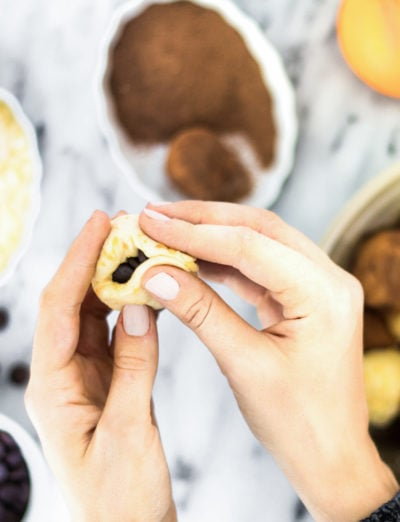 prepping for an easy monkey bread recipe with chocolate and orange flavors (or whatever floats your boat!) for the holidays! by top Houston lifestyle blogger Ashley Rose of Sugar & Cloth - #recipe #easy #christmas #holidays #quickrecipes #easyrecipe #holiday #winter