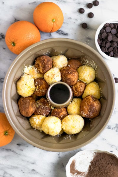 overnight prep for an easy monkey bread recipe with chocolate and orange flavors (or whatever floats your boat!) for the holidays! by top Houston lifestyle blogger Ashley Rose of Sugar & Cloth - #recipe #easy #christmas #holidays #quickrecipes #easyrecipe #holiday #winter