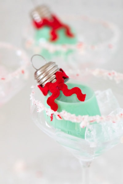 mint green cocktails! Pour your own ornament holiday cocktail! How to Make an Easy Christmas Cocktail Ornament by top Houston lifestyle blogger Ashley Rose of Sugar & Cloth #christmas #cocktail #easy #ideas #holidays #winter #ornament #decor #recipe