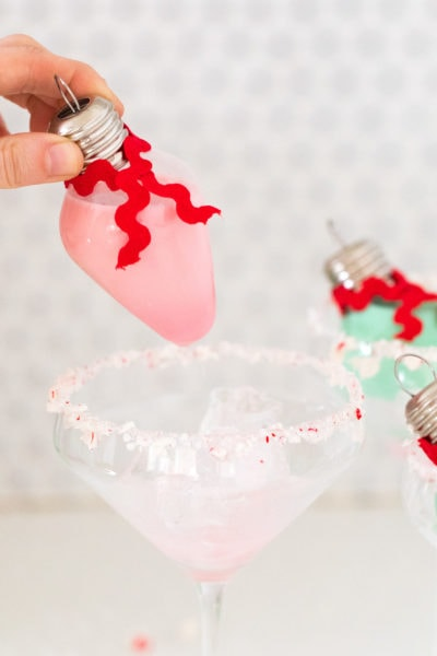unique holiday cocktails! Pour your own ornament holiday cocktail! How to Make an Easy Christmas Cocktail Ornament by top Houston lifestyle blogger Ashley Rose of Sugar & Cloth #christmas #cocktail #easy #ideas #holidays #winter #ornament #decor #recipe