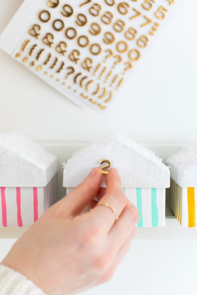 putting the numbers on - Colorful Houses DIY Advent Calendar by top Houston lifesyle blogger Ashley Rose of Sugar and Cloth #diy #christmas #advent #holiday #decor #idea #howto #kids #crafts