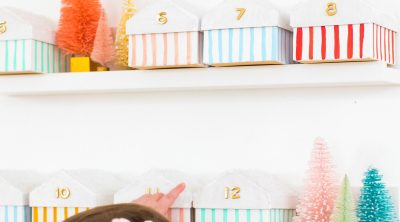 Gwen loves the colorful boxes advent calendar - Colorful Houses DIY Advent Calendar by top Houston lifesyle blogger Ashley Rose of Sugar and Cloth #diy #christmas #advent #holiday #decor #idea #howto #kids #crafts