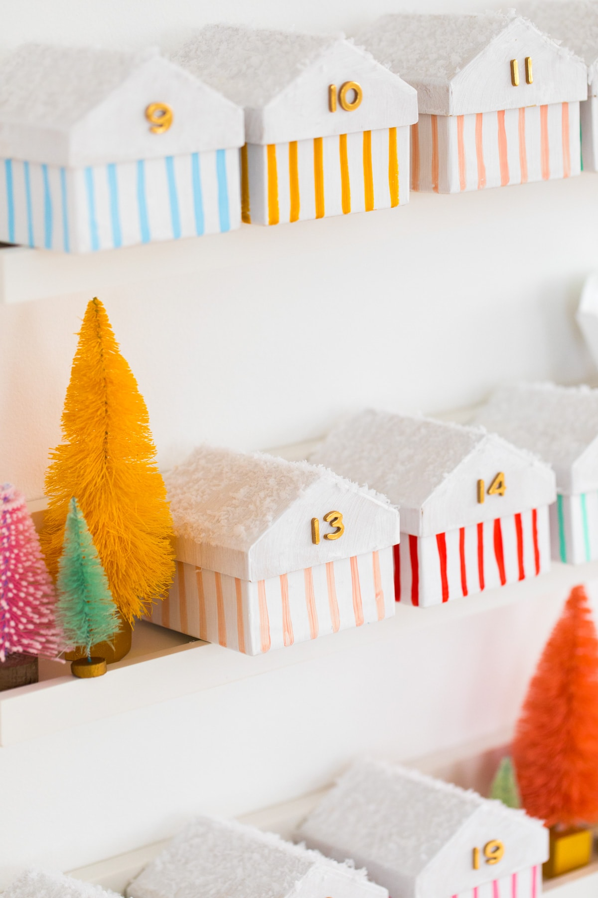 striped Christmas houses! Colorful Houses DIY Advent Calendar by top Houston lifesyle blogger Ashley Rose of Sugar and Cloth #diy #christmas #advent #holiday #decor #idea #howto #kids #crafts