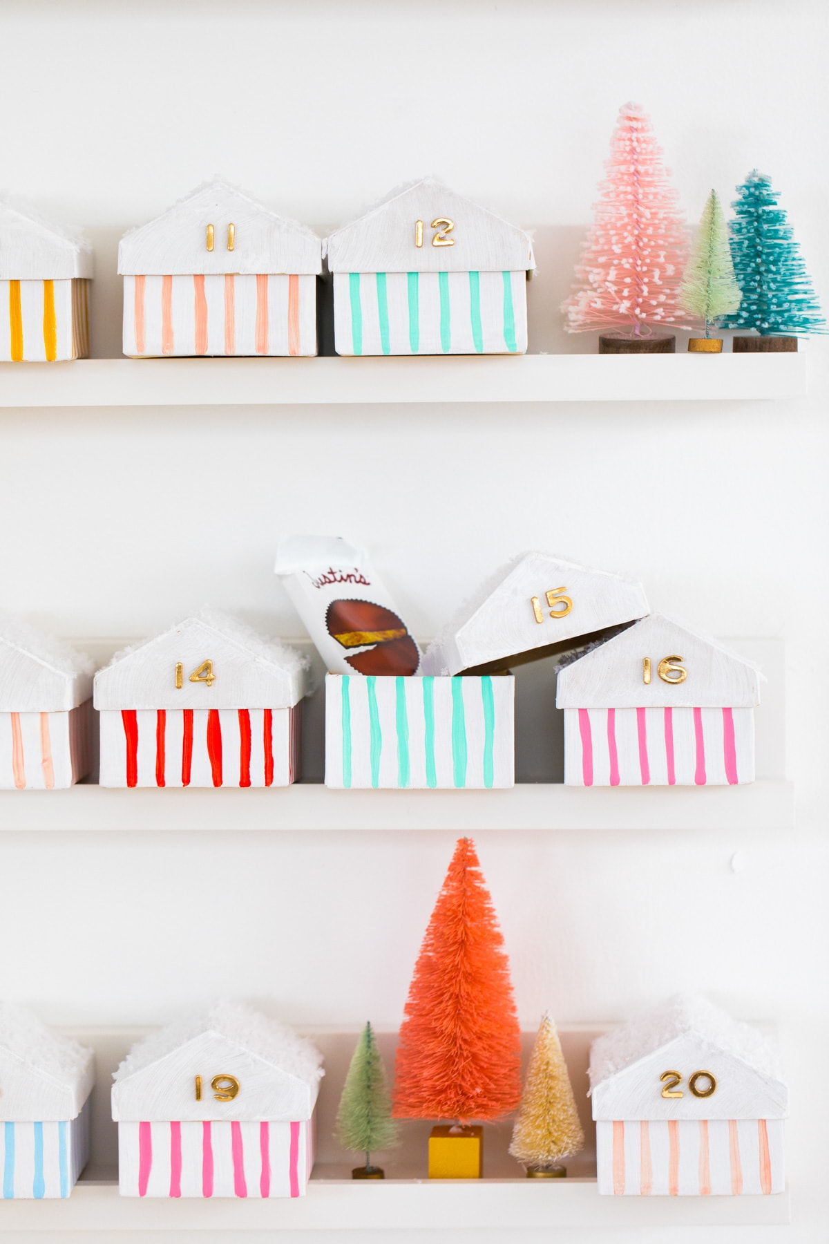 cute idea of what to put in an advent calendar! Colorful Houses DIY Advent Calendar by top Houston lifesyle blogger Ashley Rose of Sugar and Cloth #diy #christmas #advent #holiday #decor #idea #howto #kids #crafts