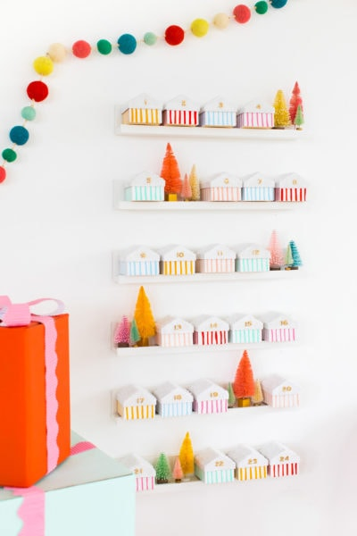 Christmas houses on temporary floating shelves - Colorful Houses DIY Advent Calendar by top Houston lifesyle blogger Ashley Rose of Sugar and Cloth #diy #christmas #advent #holiday #decor #idea #howto #kids #crafts