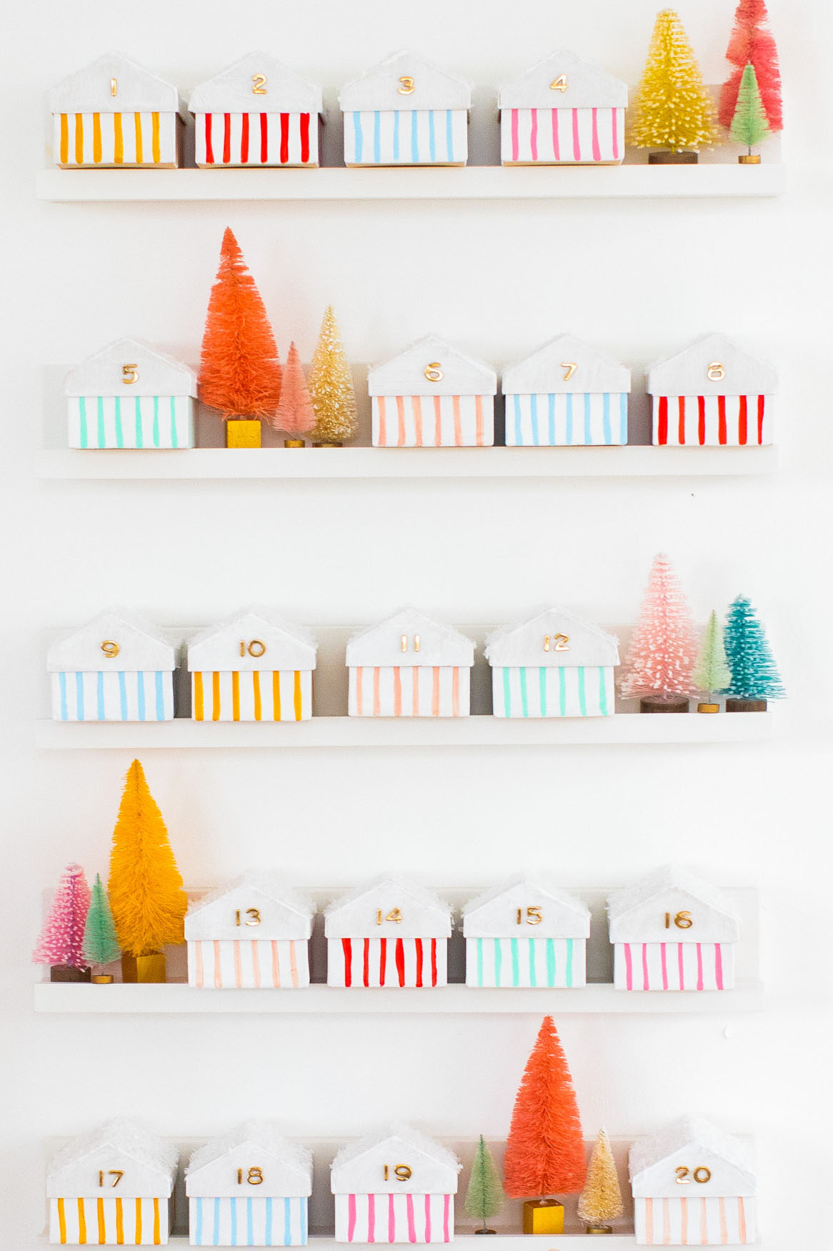 final advent calendar for kids! Colorful Houses DIY Advent Calendar by top Houston lifesyle blogger Ashley Rose of Sugar and Cloth #diy #christmas #advent #holiday #decor #idea #howto #kids #crafts
