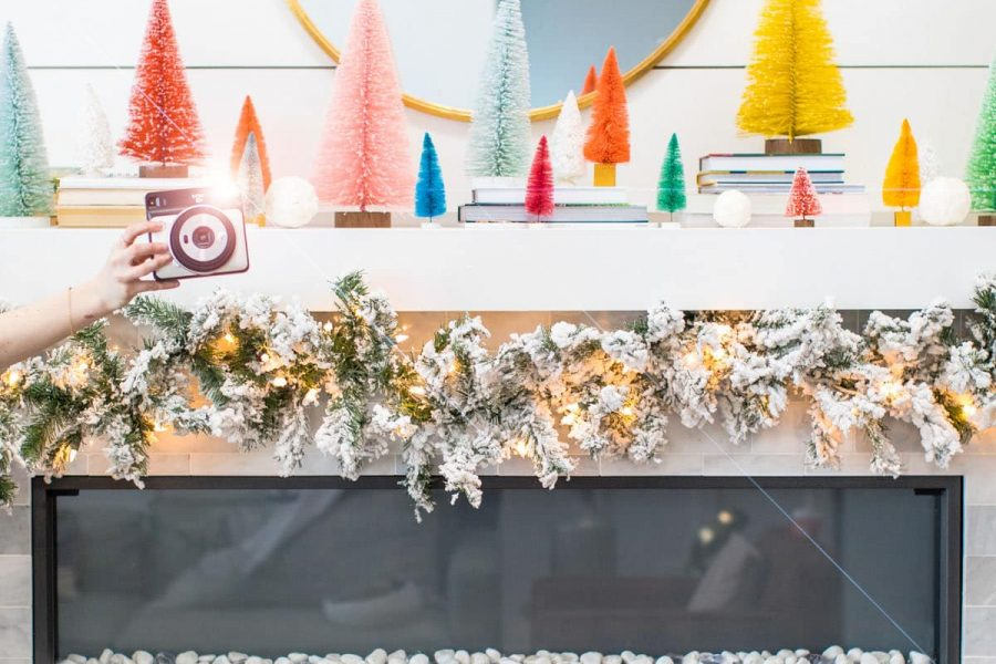 photo of a christmas mantle and camera