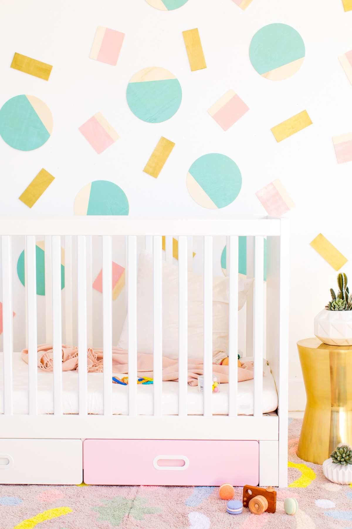 Abstract Shapes DIY Kids Wall Decor by Houston lifestyle blogger Ashley Rose of Sugar and Cloth -- #DIYBABYROOMDECOR #KRYLON #SPRAYPAINTPROJECT #NURSERYIDEAS