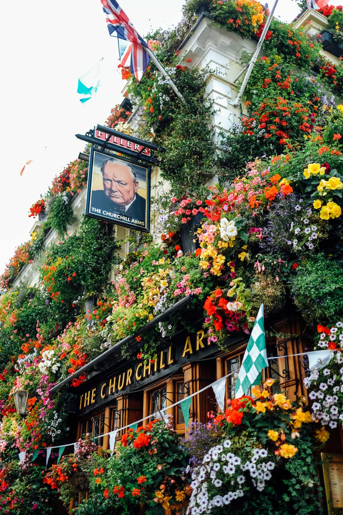 So in love with the flower wall of Churchill arms in London! Photos of Our British Isles Cruise with Family! | Part 1 # travel #familytravel #cruise #decor #design #britishisles