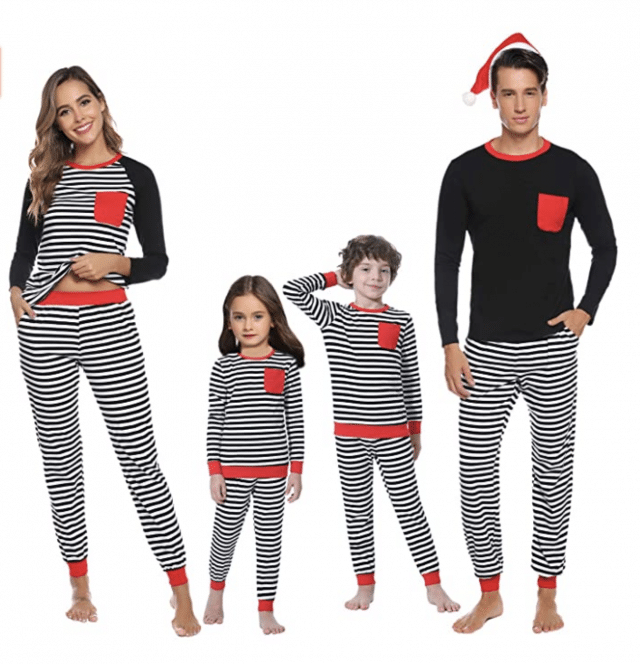 modern black and white matching family pajamas on two adults and a child