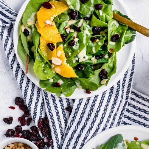 A Cranberry Orange Salad with Creamy Citrus Vinaigrette by top Houston lifestyle blogger Ashley Rose of Sugar & Cloth