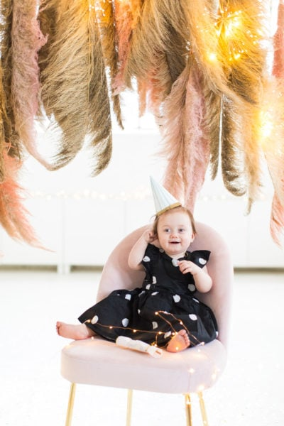 gwen in her cute little party hat! Sharing photos via Live Albums and google hub! Pampas Grass DIY Photo Backdrop by top Houston lifestyle blogger Ashley Rose of Sugar & Cloth #diy #nye #backdrop #photography #photos #google #holidays #howto #weddings #parties #entertaining