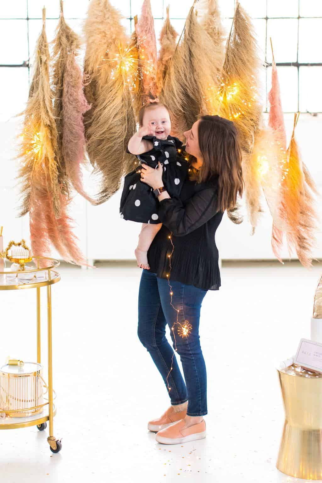 gwen and I in the photobooth! Pampas Grass DIY Photo Backdrop by top Houston lifestyle blogger Ashley Rose of Sugar & Cloth #diy #nye #backdrop #photography #photos #google #holidays #howto #weddings #parties #entertaining