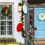 photo of a house with christmas wreaths and garland for front door decorations