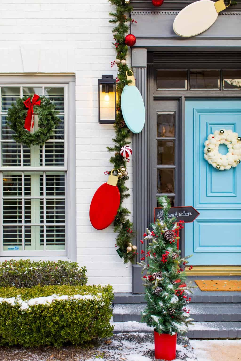 the cutest! Jumbo Lights Outdoor DIY Christmas Decorations! by top Houston lifestyle blogger Ashley Rose of Sugar & Cloth #DIY #howto #christmas #holidays #decorations #decor #home #frontdoor #entrance