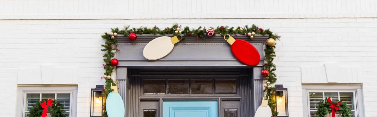 photo of a house with front door decor for christmas