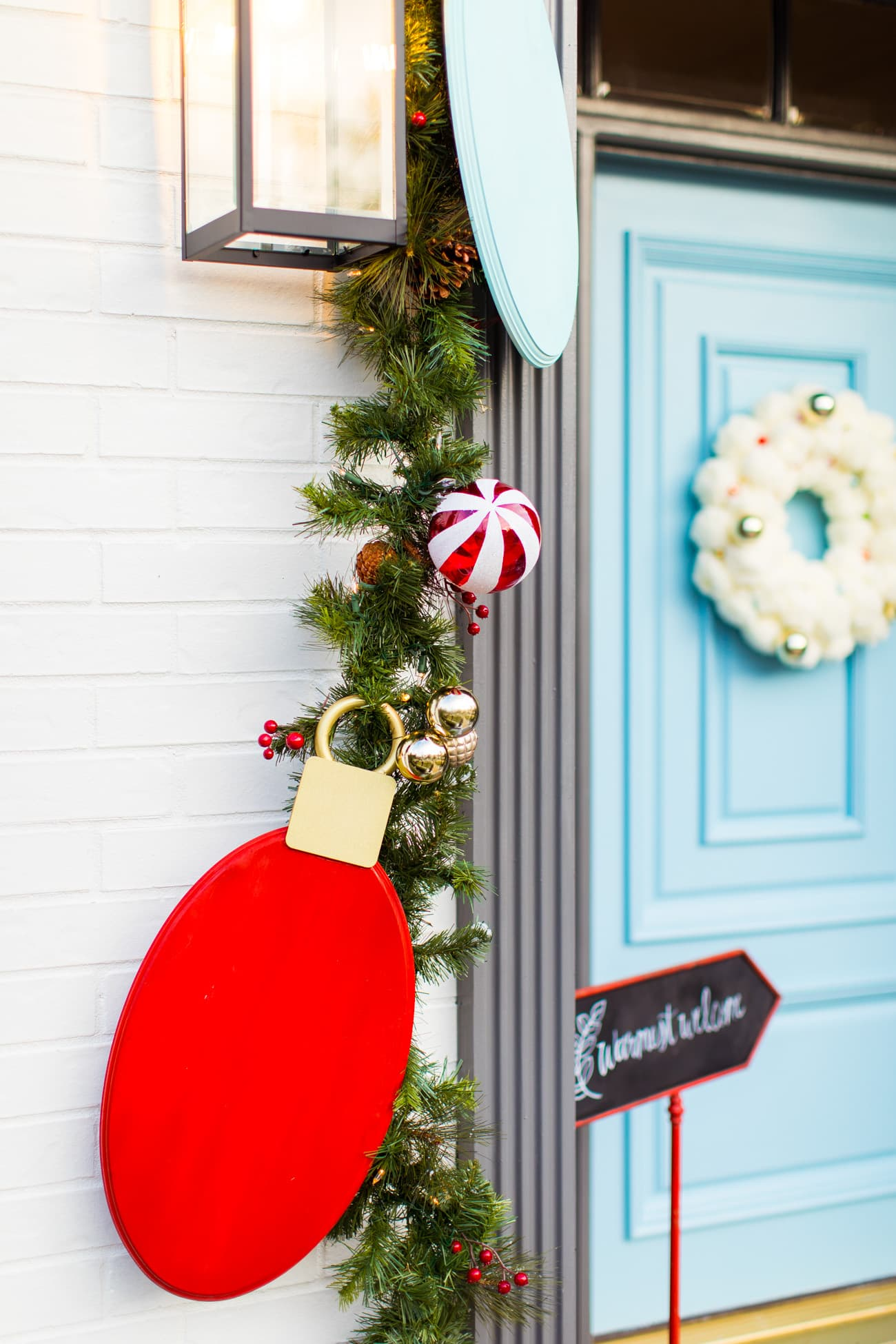 jumbo lightbulbs christmas lights! Jumbo Lights Outdoor DIY Christmas Decorations! by top Houston lifestyle blogger Ashley Rose of Sugar & Cloth #DIY #howto #christmas #holidays #decorations #decor #home #frontdoor #entrance