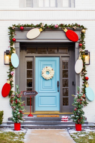 blue front door entrance for Christmas - Jumbo Lights Outdoor DIY Christmas Decorations! by top Houston lifestyle blogger Ashley Rose of Sugar & Cloth #DIY #howto #christmas #holidays #decorations #decor #home #frontdoor #entrance
