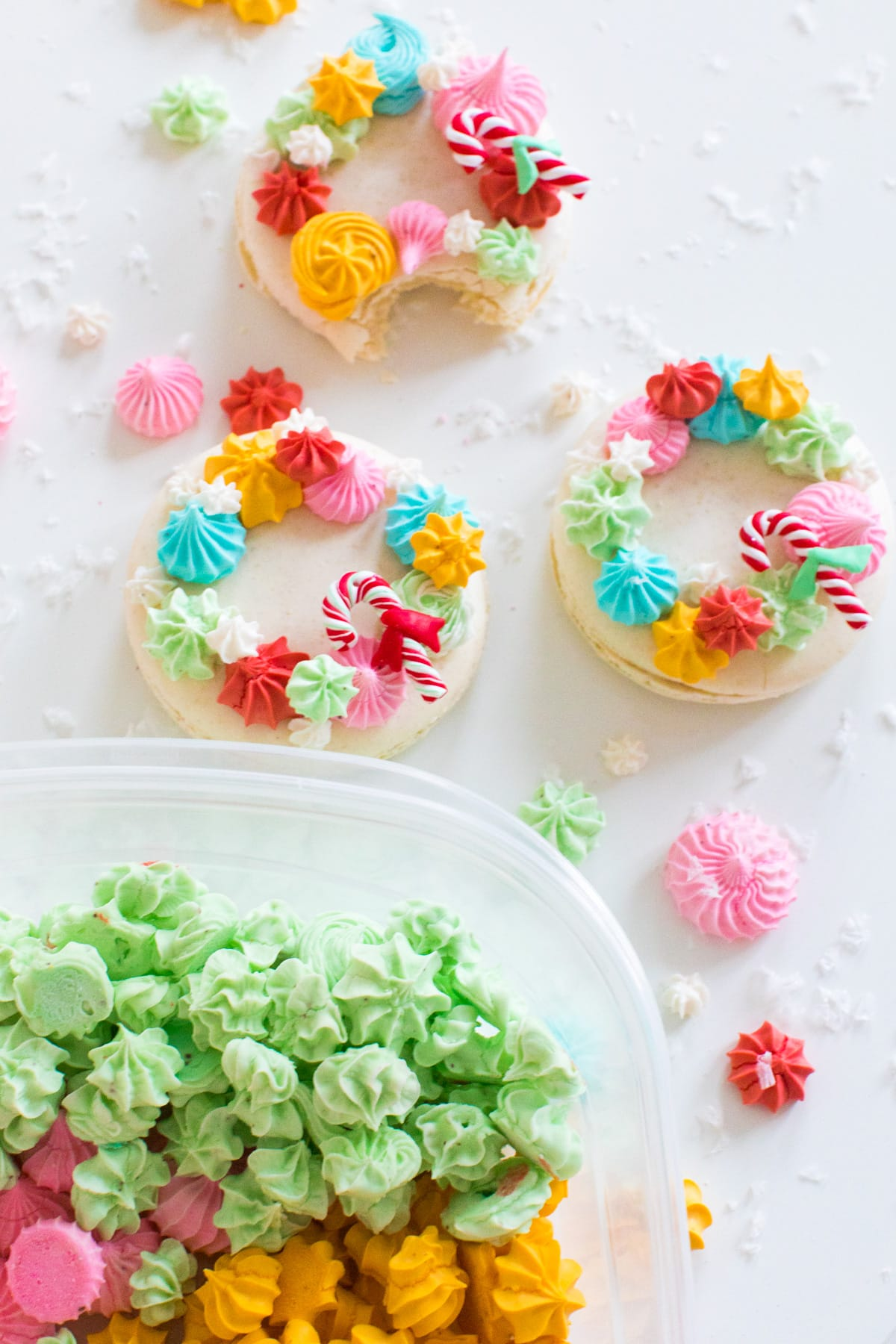 topping macarons with meringues - How to Make Holiday Wreath Meringue Macarons by top Houston lifestyle blogger Ashley Rose of Sugar & Cloth #holiday #cookies #meringues #wreath #christmas #ideas