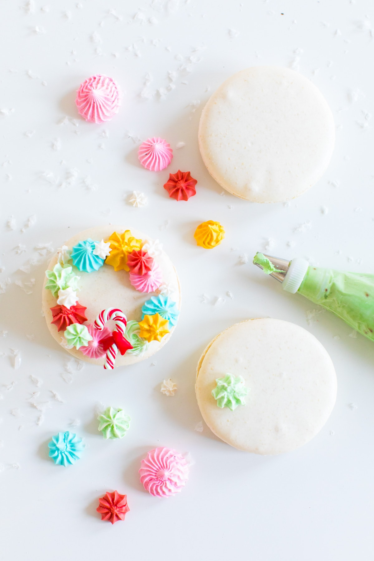 piping meringues - How to Make Holiday Wreath Meringue Macarons by top Houston lifestyle blogger Ashley Rose of Sugar & Cloth #holiday #cookies #meringues #wreath #christmas #ideas