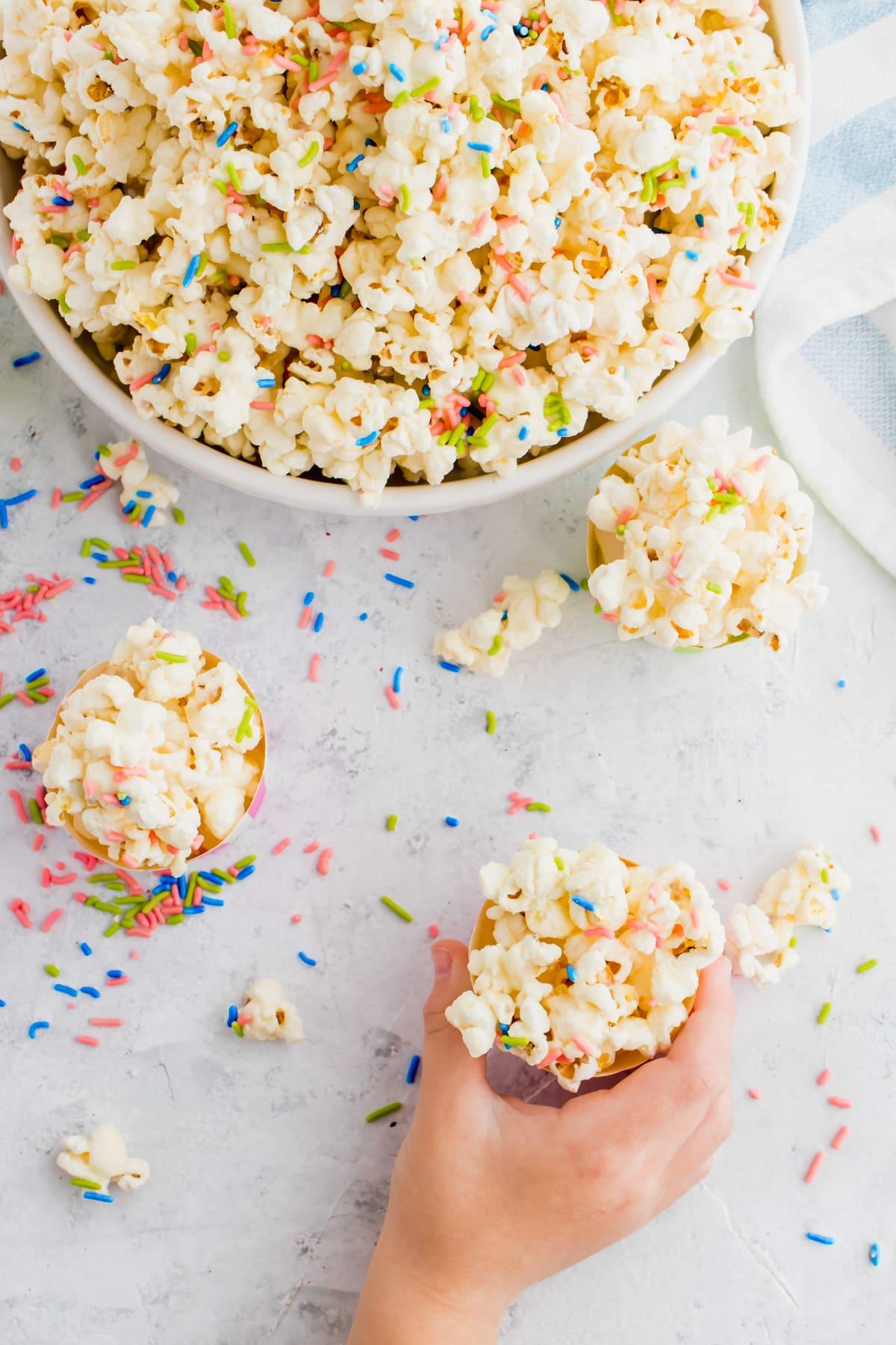 fun white chocolate funfetti popcorn by top Houston lifesyle blogger Ashley Rose of Sugar and Cloth #recipes #entertaining #idea