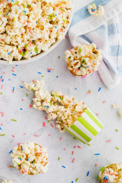 delicious white chocolate funfetti popcorn by top Houston lifesyle blogger Ashley Rose of Sugar and Cloth #recipes #entertaining #idea