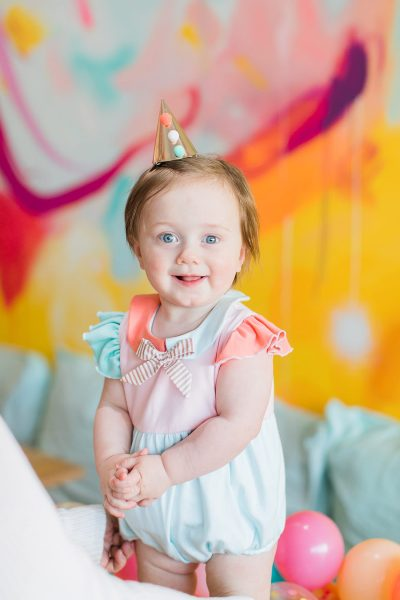 happy birthday to our sweet girl! - Gwen Turns One + Her First Birthday Party Ideas! by top Houston Lifestyle Blogger Ashley Rose of Sugar & Cloth #party #partyideas #firstbirthday #baby #birthday #howto #diy #budget #colorful