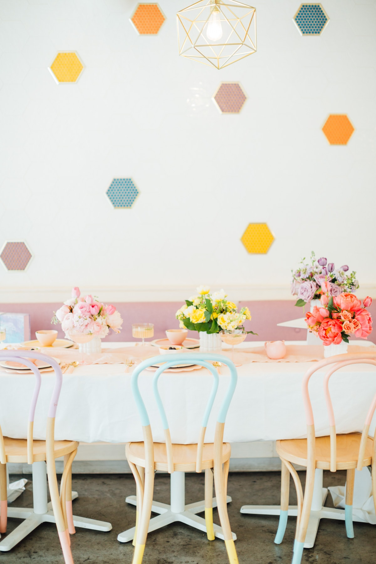 colorblock chairs! A Perfectly Pastel Easter Table Idea by top Houston lifestyle blogger Ashley Rose of Sugar & Cloth #diy #tablescape #ideas #easter #pastel #party #decorations #brunch #bridalshower #bridal #shower #baby