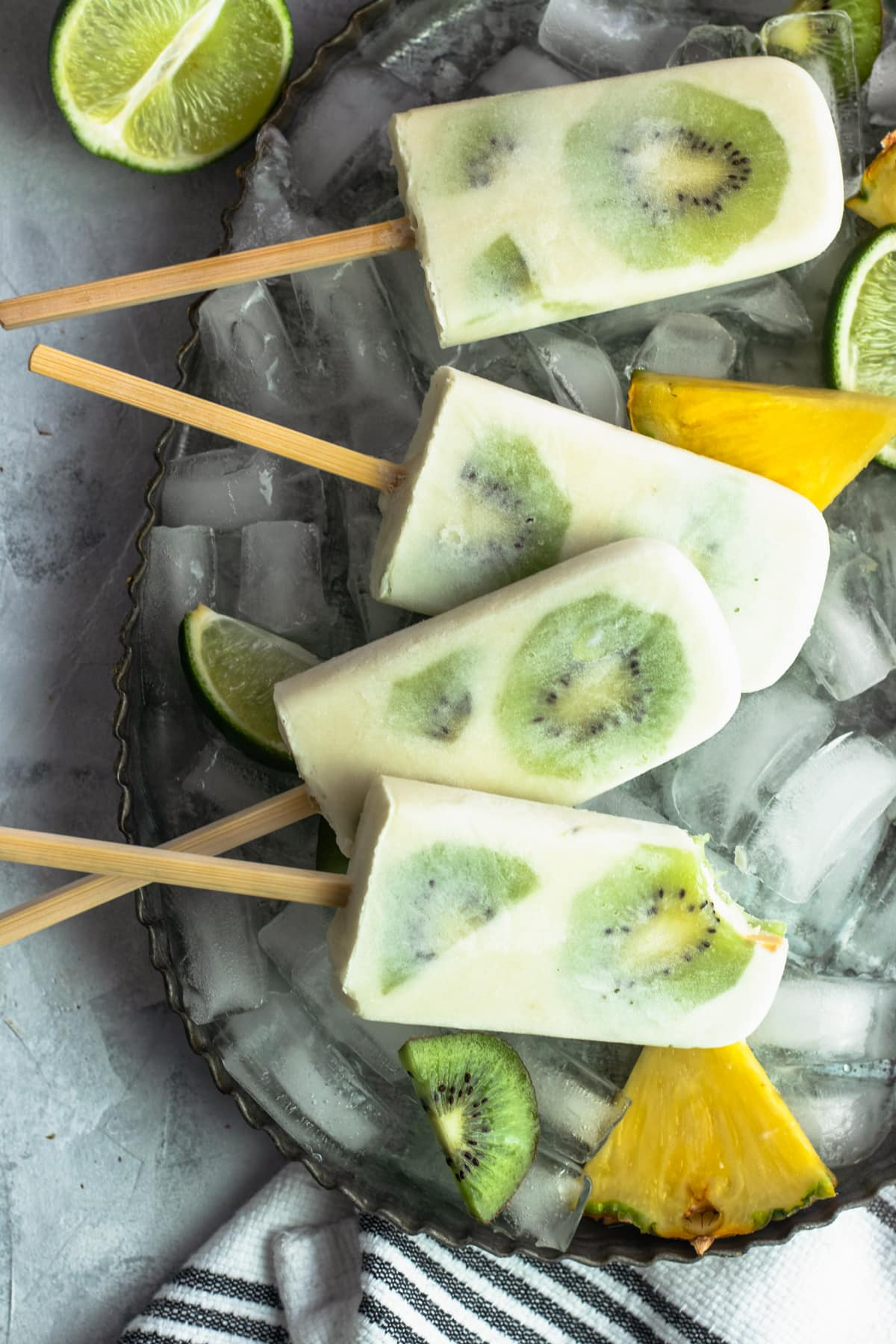 Whole 30 Tropical Popsicles Recipe Bite by top Houston lifestyle blogger Ashley Rose of Sugar & Cloth
