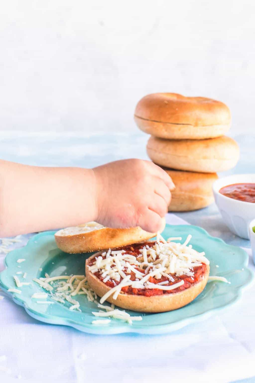 Healthy Kids Lunch Ideas Bagel Pizza Toppings by top Houston lifestyle blogger Ashley Rose of Sugar & Cloth